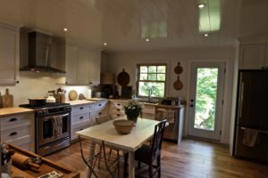 Catchacoma cottage renovation - kitchen and dining looking out to lake