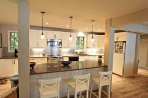 home renovation - kitchen island with pendant lighting and stools