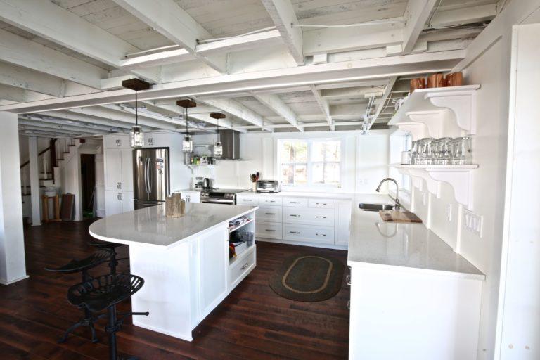 Stoney Lake cottage renovation - kitchen looking towards front entry