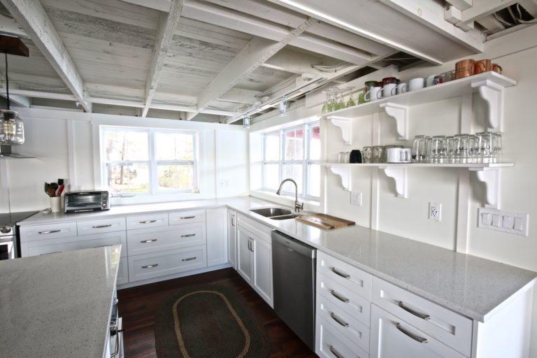 Stoney Lake cottage renovation - kitchen looking out windows to lake