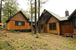 Stoney Lake island cottage renovation - bunkie exterior with cottage