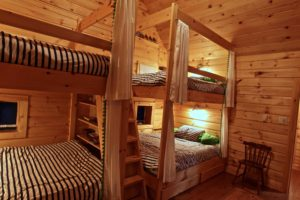 Stoney Lake island cottage renovation - custom bunkbeds in bunkie