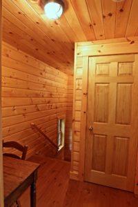 Stoney Lake island cottage renovation - walking out of bunkie into cottage