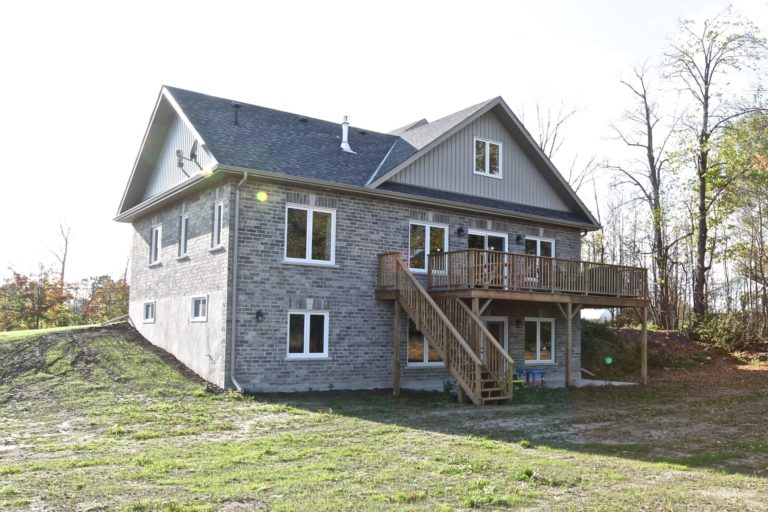 Custom Home Lakefield - Exterior from Back Yard