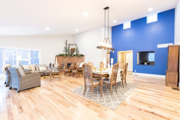 Blue accent wall and dining area